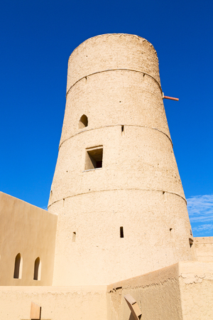 bastion: fort battlesment sky and  star brick in oman muscat the old defensive