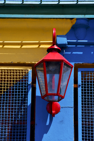red street lamp  and a colorated  wall in la boca buenos aires argentina