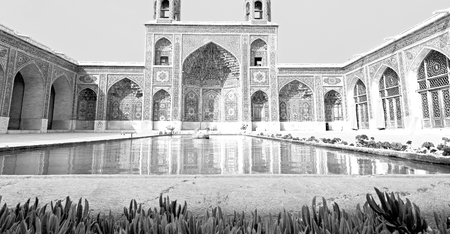 in iran the old   mosque and traditional wall tile incision near minaret Stock Photo
