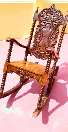 antique furniture: in  philippines old dirty terrace whith rocking chair empty