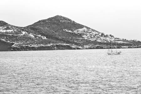 sailing in europe greece santorini island hill  and rocks on the summertime beach Stock Photo