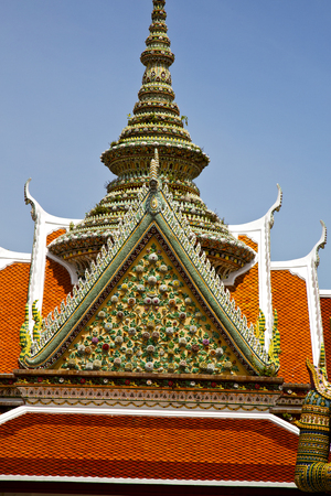 asia  bangkok in   temple  thailand abstract cross colors roof  wat    sky   and    colors religion mosaic  sunny Stock Photo