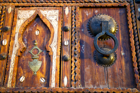 metal grey       morocco in    africa the old wood  facade home and rusty safe padlock
