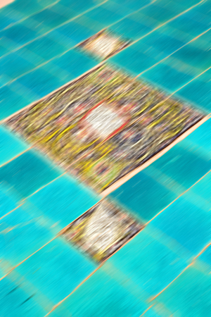 isfahan: blur in iran the old decorative flower tiles from antique mosque like background Stock Photo