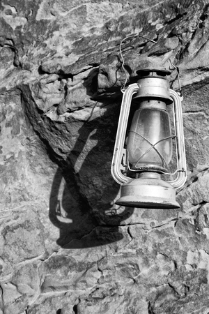 oil lamp: in the rock desert of jordan an antique old fashioned lamp isolated Stock Photo