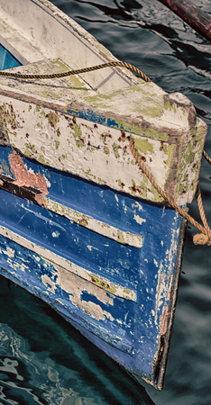 navy blue background:   philippines old dirty prow of a boat in the port like abstract