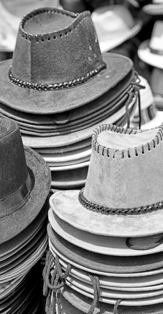 clothing store: in a old market lots of colorated hats  like background clothes