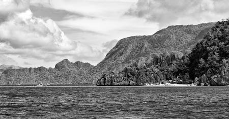 from a boat  in  philippines  snake island near el nido palawan beautiful panorama coastline sea and rock