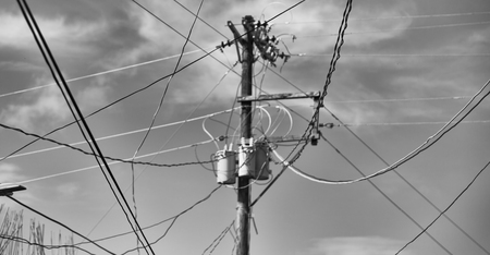 electric grid: blur  in  philippines   a electric pole with transformer and wire  the cloudy sky