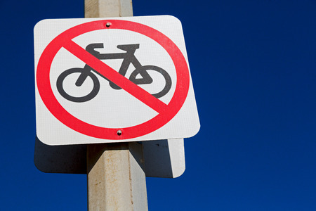 in  australia   the sign of no bike in the clear sky Stock Photo