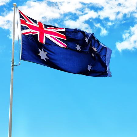 australia in the clear sky the waving flag
