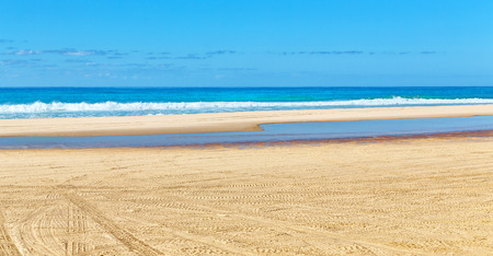 in  australia fraser island and the sand track of the cars near the ocean and sky