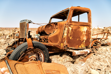 in  danakil ethiopia africa  in the  old italian village  rusty antique car and hot