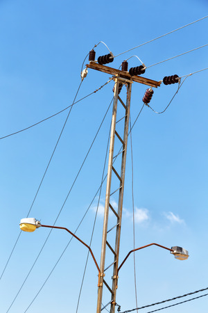 the concept of power line with electrical pole in the clear sky in australia