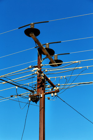 in  australia the concept of power line with electrical pole in the clear sky Stock Photo