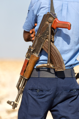 in  danakil ethiopia africa   the rifle and the back of the guard concept of safety and protection