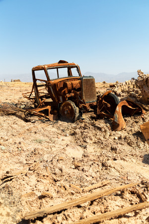 in  danakil ethiopia africa  in the   old abandoned  italian village   colony rusty antique car and hot concept of horror apocalypse