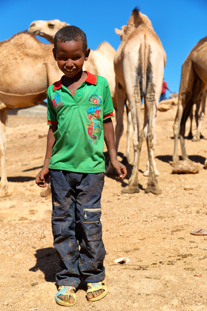 ETHIOPIA,BABILE-CIRCA  JANUARY 2018--unidentified   worker young boy in the camels market Editorial