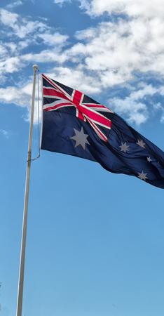 australia in the clear sky  the waving flag  Stock fotó
