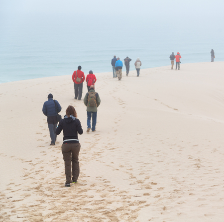 in south africa the fog and the people in the winter beach Stock Photo