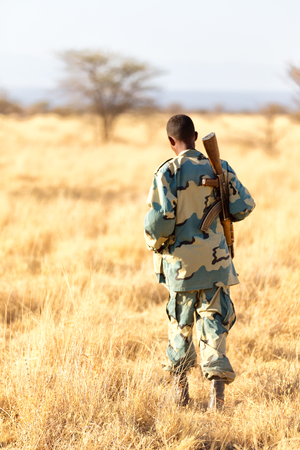 africa  in the land of ethiopia a black soldier  and his gun looking the boarder Stock Photo