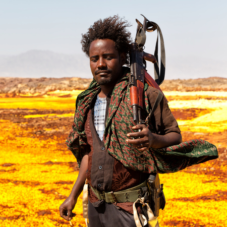 ETHIOPIA,DANAKIL-CIRCA  JANUARY 2018--unidentified irregular soldier looking at the state boarder Editorial