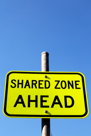 in  australia   the sign of shared zone ahead concept of safety in the empty sky Stock Photo