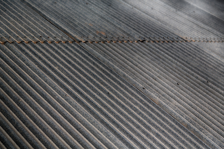 blurred abstract background texture of a corrugated metal roof