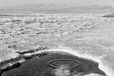 the black lake with boiling oil and hot in danakil ethiopia africa Stock Photo