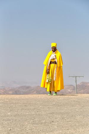 ETHIOPIA,LALIBELA-CIRCA  DECEMBER 2017--unidentified priest walking in the street