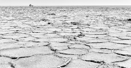 abstract background texture of the desert of salt in africa ethiopia danakil region of afar concept of wilderness and danger place with car Stock Photo