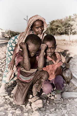 ETHIOPIA,DANAKIL-CIRCA  JANUARY 2018--unidentified   little kids near the  railway