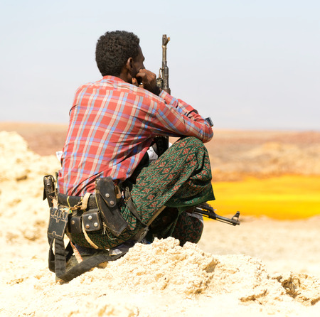 africa  in the land of danakil ethiopia a black soldier and his gun looking the boarder Editorial