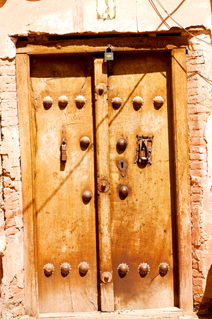 blur in iran old door near the mosque and antique construction Stock Photo