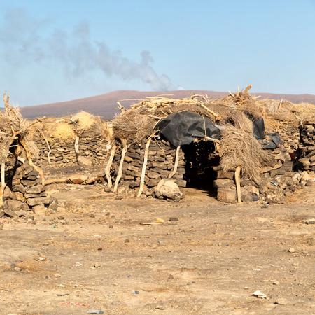 in   ethiopia africa  the poor house of people in the desert of stone Foto de archivo