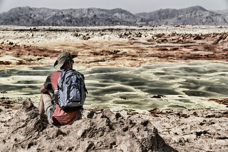 in dalol ethiopia a  backpacker near the depression volcano land Stock Photo