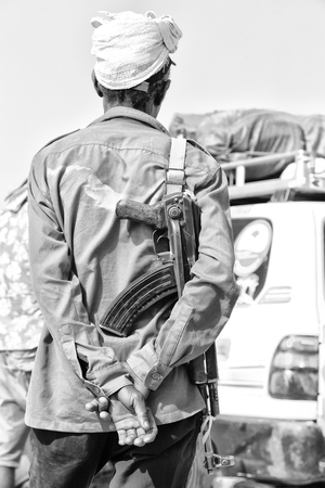 in  danakil ethiopia africa   the rifle and the back of the guard concept  of safety and protection Reklamní fotografie