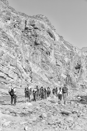in   ethiopia africa   lots of people  hiking in the  canyon empty river Editorial