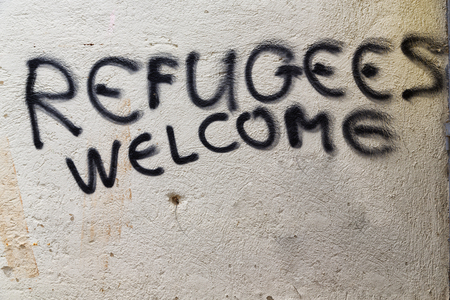 in cyprus the spray paint in the wall with refugees welcome like concept of hospitality  Фото со стока