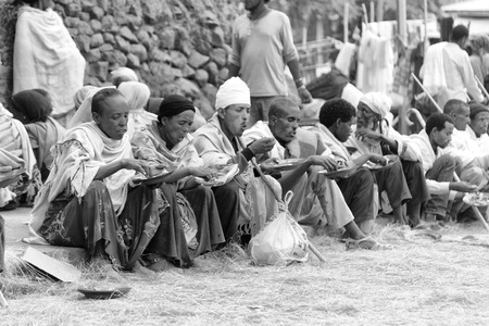 ETHIOPIA,LALIBELA-CIRCA JANUARY 2018--unidentified people in crowd of the genna celebration and food