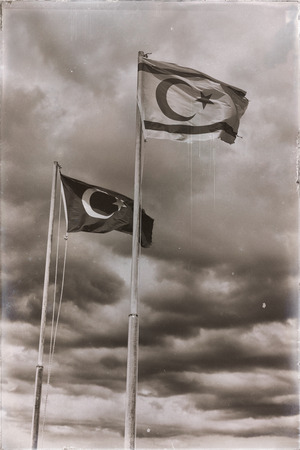 in north of cyprus the waving flag in the sky  concept of proud and occupation Stock Photo