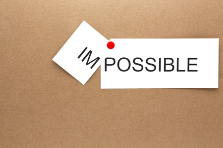 in the carboard the word imopossible cut in the first part like concept of possible and decision