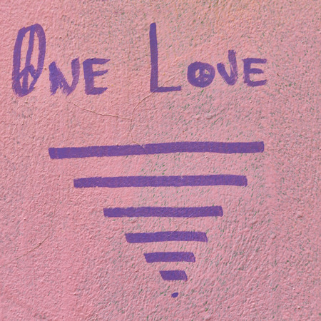 in cyprus the painted wall and the words one love likeconcept of emotion and peace