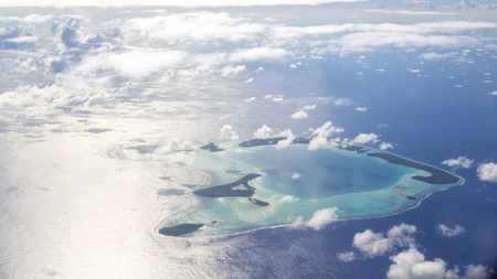 in polynesia moorea the view of the reef from the airplane cloud and ocean Archivio Fotografico