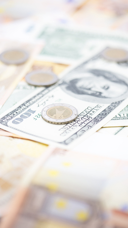 blurred dollar   euro  and coins money background like concept of differences success prosperity and business