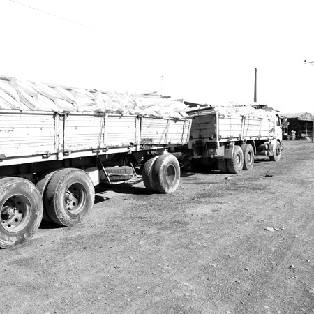 in  danakil ethiopia  africa  in the land of afar the  truck full of bags of salt near the village and flats
