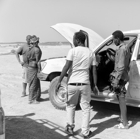 ETHIOPIA,DANAKIL-CIRCA  JANUARY 2018--unidentified  people and broken car in the land of afar people Editorial