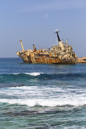 in cyprus the abandonated boat near the coastline like concept od disaster and problem