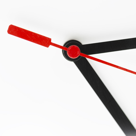 blur in the white background the clock and red arrow like concept of  waste time and work Archivio Fotografico