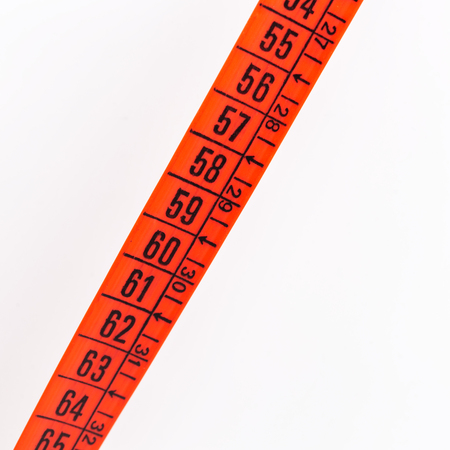 blur red  tape measure in the white light like concept of diet and lenght tool   and copy space